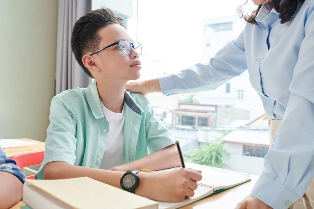 Teacher praising schoolboy